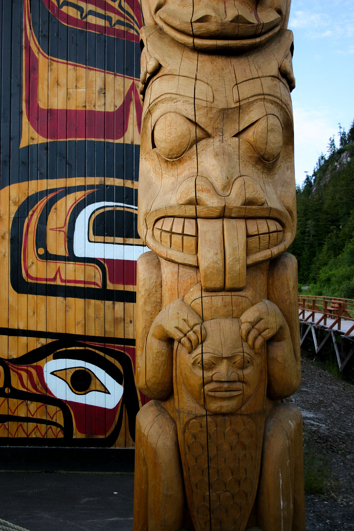 Totem pole and long house in n the village of Gingolx, British Columbia